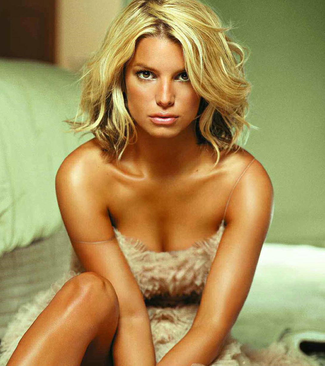 jessica simpson sitting on bed