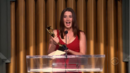 Robin receiving an award.png