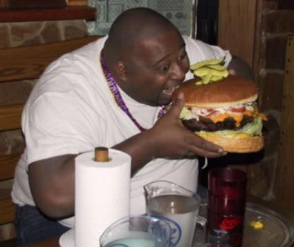 Fat-guy-eating-giant-hamburger.jpg