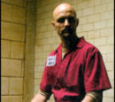 Victor Zsasz (Tim Booth)