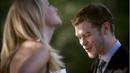 Klaus and caroline laughing together.png