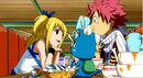 Lucy belanja Natsu dan Happy makan malam.jpg