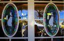 Jolly Holiday Bakery Cafe Server Penguins.jpeg