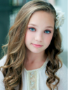 Maddie headshot from official website.png