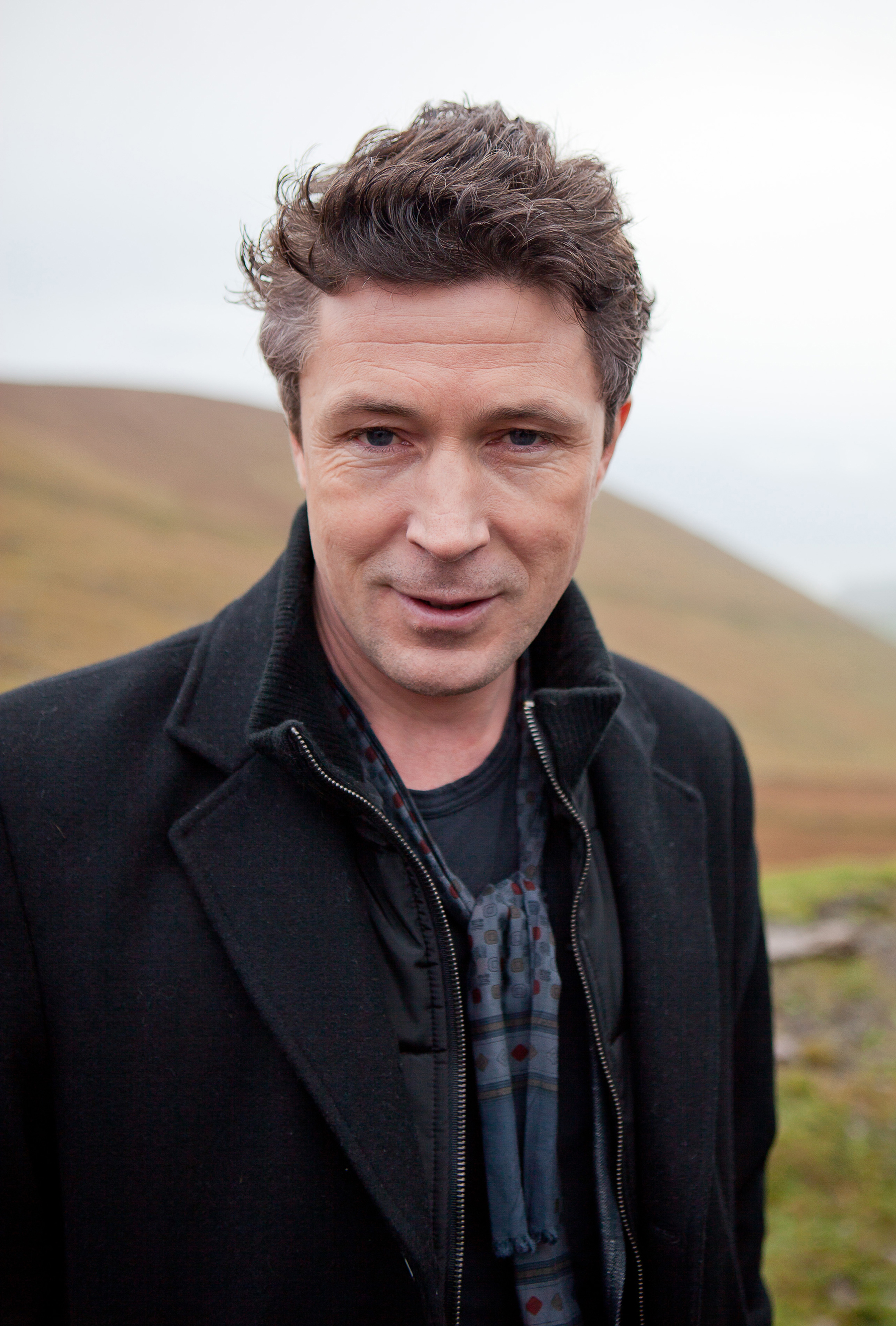 The 50-year old son of father (?) and mother(?), 178 cm tall Aidan Gillen in 2018 photo