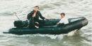007- Dickey Beer on-set of Tomorrow Never Dies with both leads.jpg