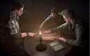 Josh, Ashley and Chris preparing the ouija board.png